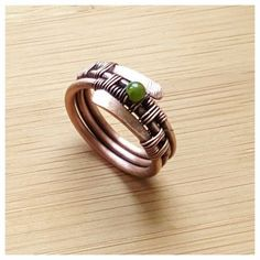 This listing is for one copper jade band ring. This gorgeouse wire wrapped ring is entirely handcrafted, hand woven with copper wire. Are you looking for a jade ring? Here it is! This unique copper ring can be a superb gift for bithday or for anniversary. This wire ring is oxidized with LOS for an antique look and gently polished by hand. Measurements: the inside diameter is 17.5mm/ the band is 1cm wide/ US size 7k #wirewrappedringsband