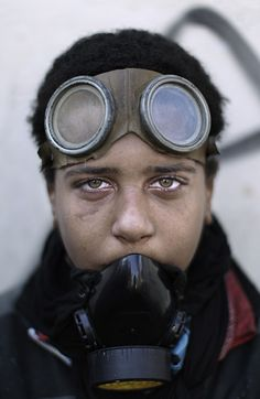 Cairo, Egypt: A protester wears a protective mask and goggles during clashes with security forces near the interior ministry