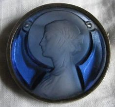 Lalique 1921 Pendant Saint-Odile, blue round glass disk w/a frosted relief depiction of the Saint Odile/ 2 holes for the necklace to attach. Signed Lalique
