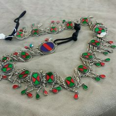 belt 46 inches Vintage look with red and green inlay type work bells price is firm unless bundled Jewelry