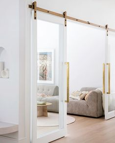 Detailed double doors—House By Three Birds Renovations x Sophie Bell, featuring Dulux White on White. Living Area, Living Room Decor, Living Spaces, Three Birds Renovations, Glass Barn Doors, Home Reno, Home And Family, Family Homes, New Homes