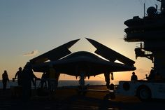 ATLANTIC OCEAN (May 14, 2013) - An X-47B Unmanned Combat Air System (UCAS) demonstrator is towed on the flight deck of the aircraft carrier USS George H.W. Bush (CVN 77). George H.W. Bush is scheduled to be the first aircraft carrier to catapult launch an unmanned aircraft from its flight deck. (U.S. Navy photo by Mass Communication Specialist 2nd Class Timothy Walter/Released)