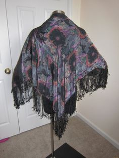 A personal favorite from my Etsy shop https://www.etsy.com/listing/212408188/floral-vintage-piano-shawl