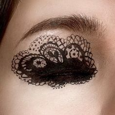 Lace eye makeup. Not good for actually wearing but good for photography.