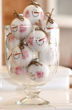 Cheap DIY Christmas Decoration Buy a set of ping ping balls and draw them like the face of Frosty the Snowman. Very cute!