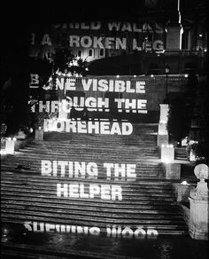 Projected text: an art project by Jenny Holzer