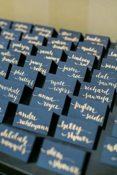 navy placecards with gold font