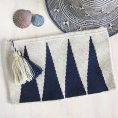 Wayuu wool clutch with generous wool tassel and zip closure. The dense…