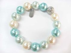 Maybe to match the pearl necklaces as long as the pearls were not too big. - Formal Aqua, Light Blue & White Pearl and Silver Rhinestone Stretch Bracelet - Blue Bridesmaid Jewelry JewelryStylist.com