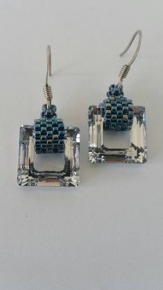 Swarovski Cosmic Squares in Crytal and Denim AB delicas make up these gloriously simple and elegant earrings designed and made by Glory.  These