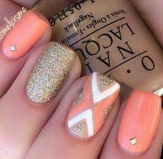 Salmon/orange and gold nails