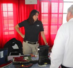 Here is HAIX North America showing off features of their boots to an interested customer.
