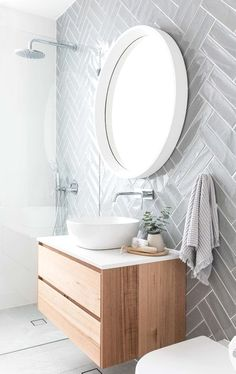 Grey herringbone subway tile on modern bathroom with floating vanity, white vessel sink and round mirror Simple Bathroom Designs, Modern Bathroom Design, Bathroom Interior Design, Bath Design, Modern Design, Tile Design, Herringbone Subway Tile, Herringbone Pattern, Subway Tiles