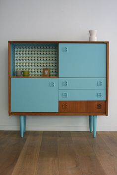 Cute mid century painted cabinet, looks like an up-cycle project, I like it.