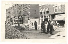ID#0433 Date: 1939 This image is the construction site, viewed from the street, of the new building at # 19 South Main Street. The workers are removing the streetcar tracks for metal needed in the war effort. This new building was built for George Bailey as Standard Drug, Oberlin's first chain drugstore. The Standard Company defined the exact characteristics of the building's interior design. Participant: Pat Stetson. Additional Sources: Pat Stetson interview 6/00.