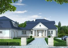 Dom jednorodzinny, parterowy z poddaszem użytkowym oraz garażem dwustanowiskowym.