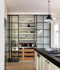 Sliding glass & blackened steel doors for open look joinery wall