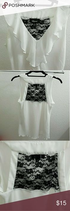 🔺White Ruffled Top Beautiful, flowy white top with black lace detailing on back and ruffle in the front. EUC  Top & lining 100% polyester Lace 90% nylon, 10% spandex Iz Byer Tops Blouses