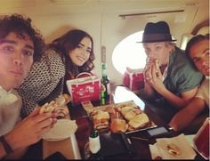 Jamie Campbell Bower, Robbie Sheehan, Kevin Zegers, and Lily Collins hanging out on the plane