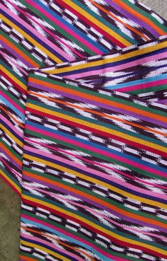 This fabric is 36 inches wide and is sold by the yard. It was hand woven in the highlands of Guatemala on a treadle loom. The weaving process is