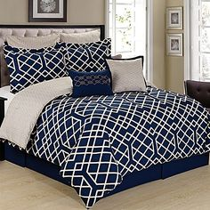Add a sophisticated look to your bedding with the luxurious Cathay Home Demetri Reversible Comforter Set. Adorned with a trellis pattern in navy and white, this ultra-soft comforter set is the perfect finishing touch to your refined bedroom décor.