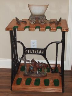 Gun rack made from a singer sewing machine base. God Almighty! I thought I had seen everything. But this takes the cake.