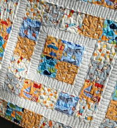 Baby boy quilt quilting detail by Material Girl Quilts, via Flickr