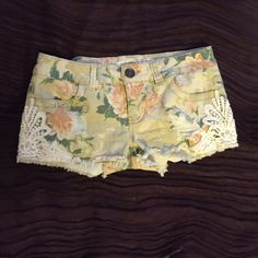 Adorable denim floral shorts Beige denim shorts with pink floral print. Crochet on the sides. Worn once. No defects or stains. Not Free People--just listed for exposure. Please feel free to make offers. Free People Shorts Jean Shorts