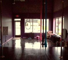 Fitness room: arial silks, lyra hoop, and pole. Maybe someday.