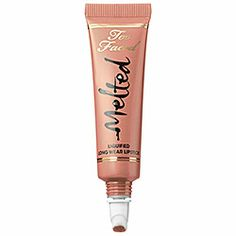 Too Faced Melted Liquified Long Wear Lipstick in Melted Nude - The shine of a gloss, lasting power of a stain, and pigment-packed color of a liquid lipstick, all in one high-impact formula. Bold, long-wearing color glides on cleanly with the precision tip applicator, delivering rich color with staying power.