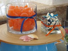 Orange slices and candy sharks. -------- Coté Weddings and Events: Orange and Blue Beach Theme Baby Shower Kids Party Themes, Beach Themes, Baby Shower Cakes, Baby Shower Themes, Shower Ideas, Beach Party Snacks, Beach Bridal Showers, Beach Shower, Wedding With Kids