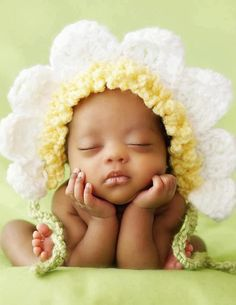 This. Is just plain cute! Crochet sunflower bonnet