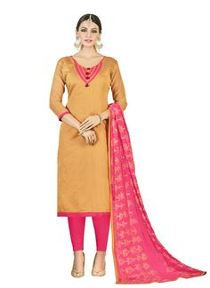 Lovely Like Rain Symbolising High Fashion. This Lovely Mustard Colored Salwar Kameez Is Fabricated In Chanderi Cotton An Is Most Suitable For A High End Occasion Where You Have To Look Absolutely Lovely. The Embroidered Designs Will Have Your Audience Drooling.
