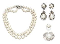 THE BARODA PEARLS - Comprising a two-strand natural pearl necklace, of sixty-eight graduated pearls; a pair of ear pendants, each suspending a drop-shaped pearl with diamond surround, to the button pearl surmount; a brooch, set with an oval-shaped pearl within a bezel-set old European and old mine-cut diamond foliate surround; and a ring, set with a button pearl flanked on either side by graduated baguette-cut diamonds, Cartier