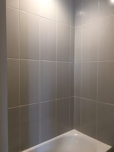 Sleek Gray Vertical Stacked Wall Tile | Daltile Showscape 12x24 Wall Tile | Shower  Design |