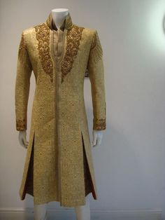 Gold Sherwani and amazing handwork. Beauty is in details. To get your own detailed outfit visit www.faaya.in