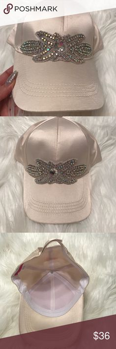 NWT Gorgeous satin baseball cap with bling design Beautiful baseball cap. Cream satin material. Gorgeous multi color bling on top. It's like wearing jewelry. Gorgeous! Brand new. Accessories Hats