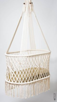 "Cradles that help your baby sleep . . . like a baby! Cradle in Macrame Knots. Cream color. TOP QUALITY. Designer: Hang A Hammock Collective this is a PREORDER ! SUPER GOOD NEWS: YOU CAN TRACK YOUR PARCEL WORLDWIDE The hanging crib is made with care and love by Veronica, Yersi, Martin, David and Alonso; the mattress and the sheets are made by Marlene, an expert seamstress and grandmother. All are permanent artisans of our team ""Hang A Hammock Collective"", regularly employed. We deliver Values…"