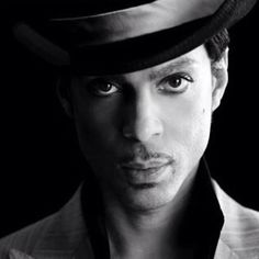 Prince  (Prince Rogers Nelson)  Split light; just a hint of Rembrandt.  The second cheek is barely barely lit but there is enough light to catch both eyes. Tension between lit side of the face and the lit eye on the dark side of the face adding drama.