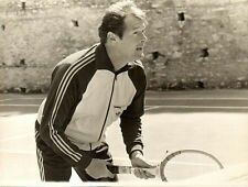 A really rare shot of Roger playing a bit of tennis on the courts.
