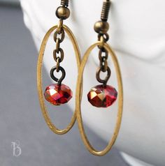 antique brass oval hoops with deep red faceted crystal earrings by mybellastoria.etsy.com