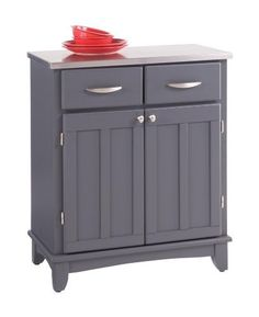 Home Styles Buffet of Buffets Stainless Steel Top Small Buffet Server in Gray Finish by Home Styles. $299.00. Some assembly may be required. Please see product details.. Dining and Kitchen->Sideboards and Servers. Server Sideboard with Stainless Steel Top Grey Finish. Dining and Kitchen. The Buffet of Buffets Small Buffet Server is constructed of hardwood and wood products in a gray finish and an 18 gauge stainless steel top. It features two utility drawers and a lower ca...