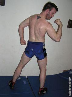 a hairy back wrestler tattooed guy