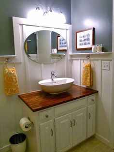 A butcher block top turns this vanity high end. From Unbelievable Budget Bathrooms Guest bathroom :D Ikea Vanity, Diy Vanity, Vanity Tops, White Vanity, Painted Vanity, Wooden Vanity, Budget Bathroom, Bathroom Ideas, Bathroom Makeovers
