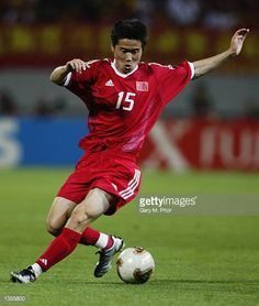 Junzhe Zhao of China runs with the ball during the FIFA World Cup Finals 2002 Group C match between Brazil and China played at the SeogwipoJeju World...
