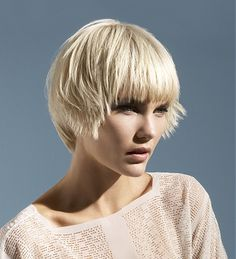 A short blonde straight choppy bob coloured Layered hairstyle by Peter Prosser