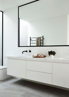 Black and White Bathroom Design . Black and White Bathroom Design . A Contrasting Black and White Bathroom Echoes the Floor Laundry In Bathroom, Bathroom Faucets, Bathroom Storage, Small Bathroom, Bathroom Black, Bathroom Mirrors, Bathroom Hardware, Master Bathroom, Modern White Bathroom