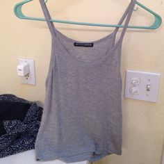 Brandy Melville stretchy grey tank size s! only worn a couple of times- perfect condition. originally purchased for $18. super soft and stretchy :) Brandy Melville Tops Tank Tops