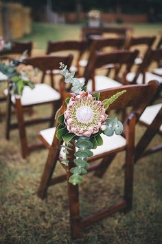Protea wedding ceremony chair decor | Kate Drennan Photography