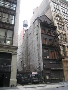 Building in Flatiron Collapses (22 West 24th Street) 22 West 24th Street, NYC. Where architect Stanford White lived, when he rented the second and third floors, of the building. It became the location, where he carried on an affair with Evelyn Nesbit, during NYC's Gilded Age. The Building collapsed in c.2007. ~~ {cwl}